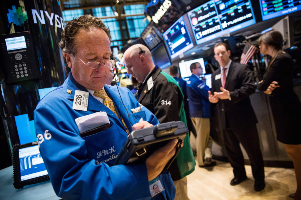 NEW YORK, NY - APRIL 07: A trader works on the floor of the New York Stock Exchange during the afternoon of April 7, 2014 in New York City. The Dow fell more than 160 points by the end of trading as technology stocks slipped. (Photo by Andrew Burton/Getty Images)